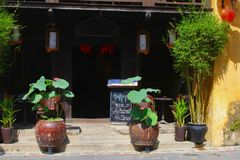 Cafe restaurant terrace happy hour board green plants, Hoi An. Outdoor terrace with green garden plants and flower pots and chalk board with happy hour sign and royalty free stock image