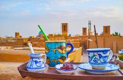 Cafe on the roof, Yazd, Iran. Enjoy refreshing drinks and dates in traditional cafe on the roof with a view on old adobe buildings and badgirs windcatchers stock image