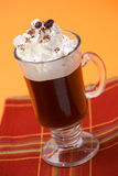 Cafe Royal Cocktail - Coffee Warmers. Closeup of tasty Cafe Royal Cocktail, Baileys, Drambuie, Tia Maria, coffee and whipped cream - Coffee Warmers series stock photos