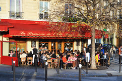 Cafe scene in Paris. Street cafe in Paris, France, in the evening sun Stock Images