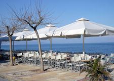 Cafe by the sea. Cafe tables situated on the beach royalty free stock images