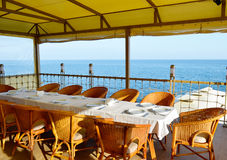 Cafe by the sea. Cafe near the sea. Decorated table covered with a white tablecloth. no one Stock Images