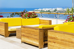 Cafe with sea view and big yellow soft sofas Royalty Free Stock Images