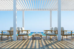 Cafe on a seaside, white armchairs Stock Images