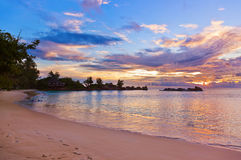 Cafe on Seychelles tropical beach at sunset Stock Photography