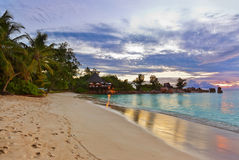 Cafe on Seychelles tropical beach at sunset Stock Image