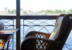 Cafe on the shore. Chair and table on the banks of the Neva River in St. Petersburg Royalty Free Stock Photo