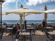 Cafe on the shores of the Mediterranean Sea Spring sunny day. Royalty Free Stock Photo