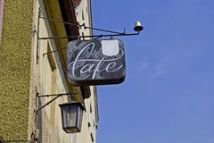Cafe sign. On wall with lamp Stock Photography