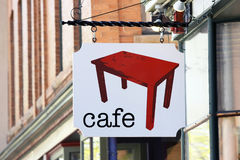 Cafe Sign. Sign for sidewalk cafe with red table Stock Image