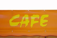 Cafe sign. Yellow text on bright orange background with room for text Royalty Free Stock Photo