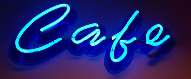 Cafe sign. Neon sign spelling out the work cafe Stock Photo