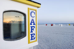 Cafe sign on an empty beach Stock Photo
