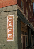 Cafe sign on historic brick building Stock Images
