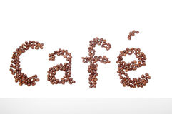 Cafe sign made of coffee beans. Isolated on white background Royalty Free Stock Photos