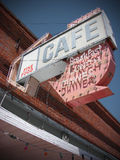 Cafe sign on old abandoned building Stock Photography
