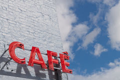 Cafe Sign. Red Cafe Sign Against Blue Sky Stock Photo