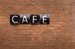 Cafe sign on red bricks wall Stock Photography