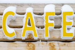 Cafe sign and snow Stock Photos