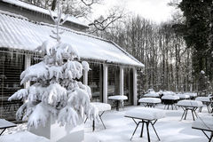 Cafe with snow. Winter landscaper. Garden furniture melting after a snowstorm Stock Photo