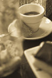 Cafe society. Modern british cafe with espresso, chocolate biscuit, sugar cubes, biscotti and funky crockery stock photography