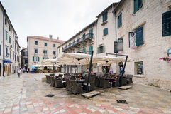 Cafe Street. Kotor. KOTOR, MONTENEGRO - MAY 17, 2013: Old Kotor City in Montenegro, Europe as the people are enjoy at the cafe. On May 17, 2013 in Kotor Royalty Free Stock Photography