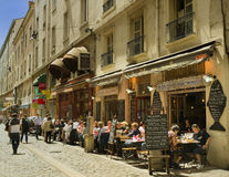 Cafe Street, Lyon, France. People are dining in the small cafes known as bouchons in Lyon, France on the Rue des Marrionners, a street located in the Bellecour Stock Photo