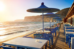 Cafe on sunset beach  with beautiful view to the Mediterranean S Stock Photos