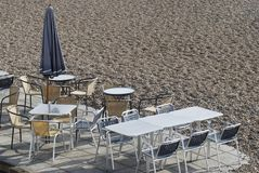 Cafe table and chairs on Brighton Beach Royalty Free Stock Photo