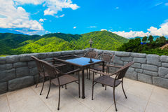 Cafe table and chairs with mountain view Royalty Free Stock Photography
