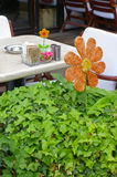 Cafe table with flower decoration Stock Photo