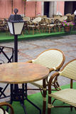 Cafe table in rain Royalty Free Stock Photos