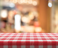 Cafe table with red checked tablecloth Stock Photo