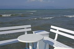 Seafront with table and bench Royalty Free Stock Photos