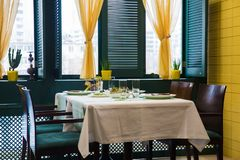 Cafe, table setting, yellow and green color stock photography