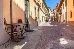 Cafe table on the street in Alba, Italy. Stock Image