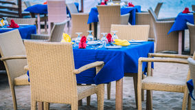 Cafe Table on a tropical sandy beach with sea on background, Nusa Dua, Bali Stock Photo