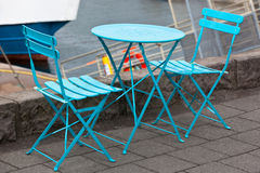 Cafe table and two portable chairs Stock Photo