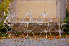 Cafe tables. Old cafe tables outside in autumn royalty free stock photography