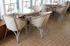 Cafe tables. Near window on wood floor royalty free stock photos