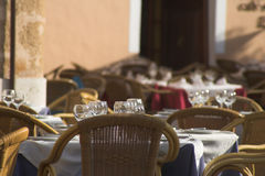 Cafe tables. Tables laid with white cloth & glasses outdoor cafe Stock Photos