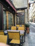 Cafe tables and chairs at Polidor Restaurant in Paris Royalty Free Stock Photo