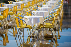 Cafe tables and chairs standing in the flood Royalty Free Stock Photo