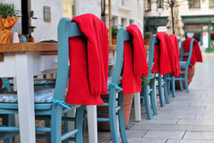 Cafe tables and chairs in the street Stock Photo