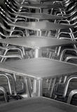 Cafe tables. Empty cafe tables and chairs steel in a row stock photos