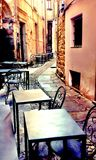 Outdoor cafe tables and chairs in historic Italy Royalty Free Stock Photography