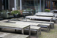 Cafe tables in the open air. Wooden table and bench Royalty Free Stock Photography