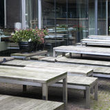 Cafe tables in the open air. Wooden table and bench Stock Images