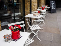 Cafe tables outside a restuarant Royalty Free Stock Photos