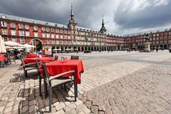 Cafe tables with in Plaza Mayor. Cafe tables with red tableclothes in Plaza Mayor. Madrid royalty free stock images